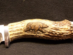 Knife With a Deer Antler Handle & Bear Engraving